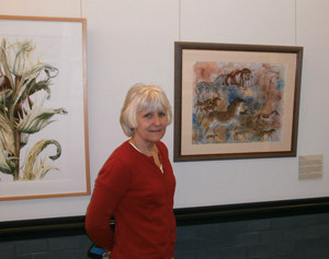 photo of gnsi-ne member nancy minnigerode in front of her piece at the new haven exhibit